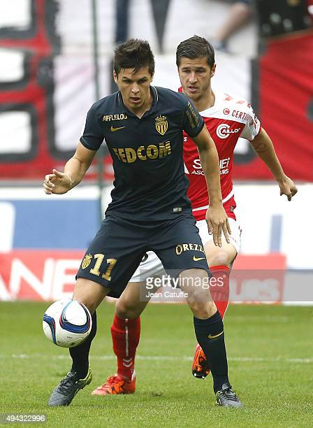 Guido Carrillo of Monaco and Anthony Weber of Stade de Reims in action during the French Ligue 1 match between Stade de Reims and AS Monaco at Stade...