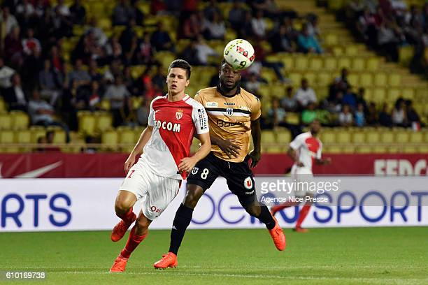 Guido Carrillo of Monaco and Ismael Traore of Angers during the Ligue 1 match between AS Monaco and Angers SCO at Louis II Stadium on September 24...