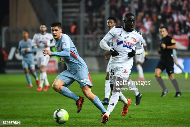 Guido Carrillo of Monaco and Issa Cissokho of Amiens during the Ligue 1 match between Amiens SC and AS Monaco at Stade de la Licorne on November 17...
