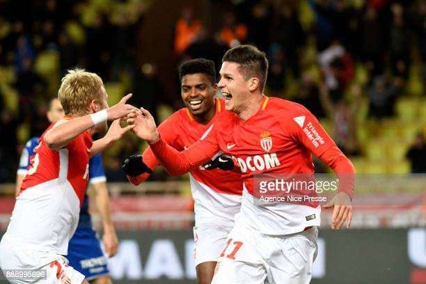 Guido Carrillo of Monaco celebrates scoring his goal with teammates during the Ligue 1 match between AS Monaco and Troyes Estac at Stade Louis II on...