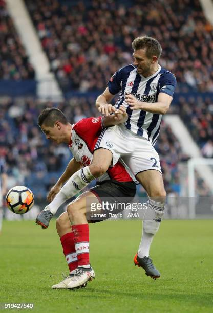 Guido Carrillo of Southampton and Gareth McAuley of West Bromwich Albion during The Emirates FA Cup Fifth Round match between West Bromwich Albion...