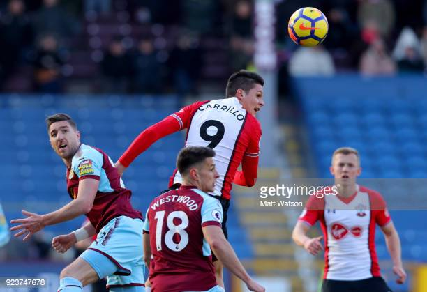 Guido Carrillo of Southampton and Stephen Ward of Burnley during the Premier League match between Burnley and Southampton at Turf Moor on February 24...