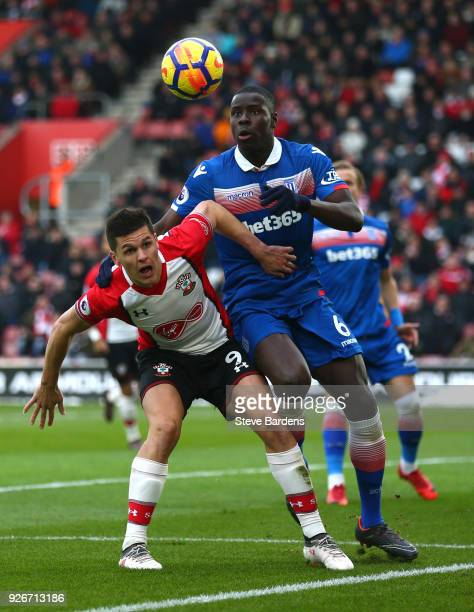 Guido Carrillo of Southampton battles for possesion with Kurt Zouma of Stoke City during the Premier League match between Southampton and Stoke City...