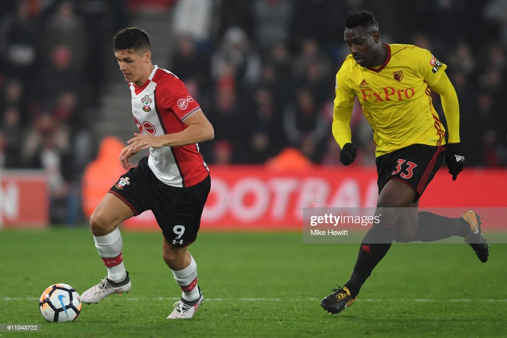 Guido Carrillo of Southampton is challenged by Stefano Okaka of Watford during The Emirates FA Cup Fourth Round match between Southampton and Watford at St Mary's Stadium on January 27, 2018 in Southampton, England.