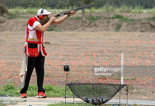 Guido Cogorno President of the Peruvian Shooting Federation congratulates Nicolas Pacheco of Peru during the Men's Skeet Qualifications on day 3 of...