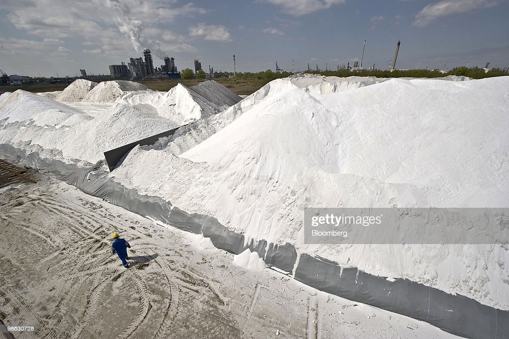 Guido De Rycke, an inspector with Solvay SA, checks a pile of salt used in the production of chlorine at the company's chemical plant in Antwerp, Belgium, on Thursday, April 22, 2010. Confidence within Europe�s chemical industry has risen for the first time in 21 months, ICIS news reported, citing data from the European Chemical Industry Council. Photographer: Jock Fistick/Bloomberg via Getty Images