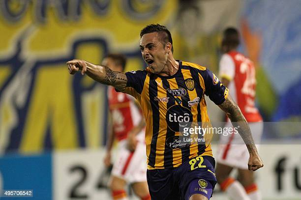 Guido Di Vanni of Sportivo Luqeno celebrates after scoring the first goal during a first leg semi final match between Sportivo Luqueno and...