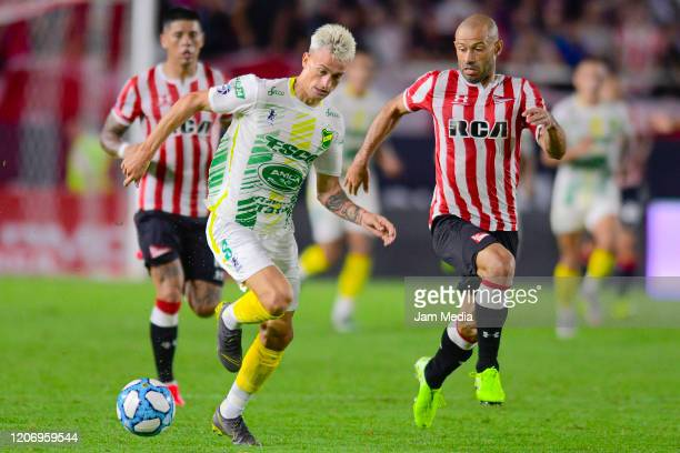 Guido Mainero of Defensa fights for the ball with Justicia fights for the ball with Javier Mascherano of Estudiantes during a match between...
