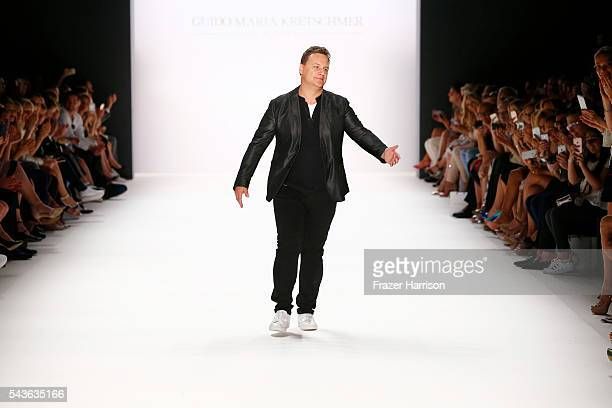 Guido Maria Kretschmer acknowledges the applause of the audience at the runway after his show during the MercedesBenz Fashion Week Berlin...