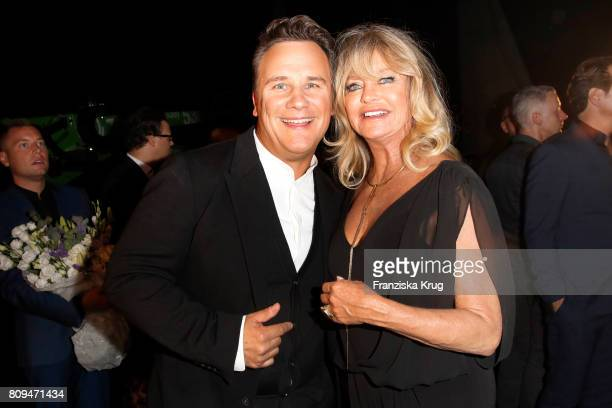Guido Maria Kretschmer and Goldie Hawn attend the Guido Maria Kretschmer Fashion Show Autumn/Winter 2017 presented by OTTO at Tempodrom on July 5...