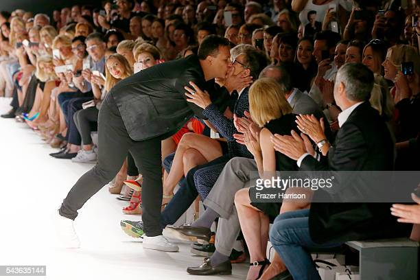 Guido Maria Kretschmer kisses his husband Frank Mutters after his show during the MercedesBenz Fashion Week Berlin Spring/Summer 2017 at Erika Hess...