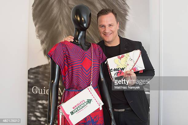 Guido Maria Kretschmer poses with his newly designed clutch for Wrigley's Spearmint on July 27 2015 in Berlin Germany