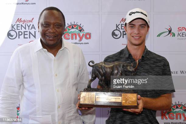Guido Migliozzi of Italy is handed the trophy by Kenya President Uhuru Kenyatta after he wins the tournament on during Day Four of the Magical Kenya...