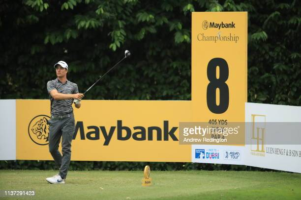 Guido Migliozzi of Italy plays his shot off the 8th tee during Day One of the Maybank Championship at Saujana Golf Country Club Palm Course on March...