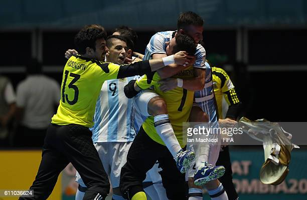 Guido Mosenson of Argentina and Nicolas Sarmiento of Argentina celebrate at the final whistle during the FIFA Futsal World Cup Semi Final match...