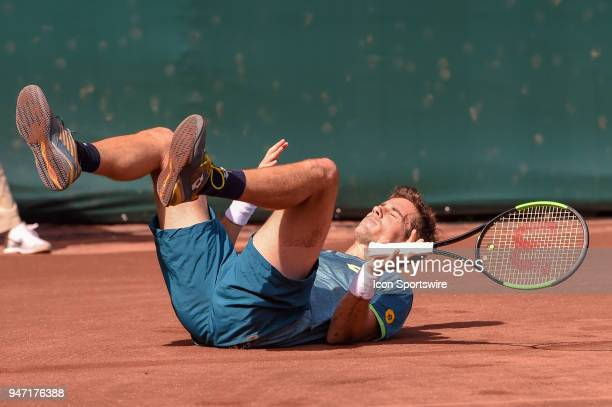 Guido Pella grimaces after slipping on the clay court during his match against Sam Querrey during the 2018 US Men's Clay Court Tennis Championships...