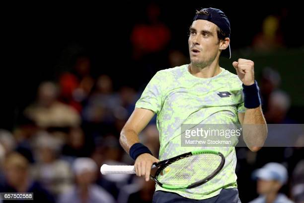 Guido Pella of Argentina celebrates a point against Grigor Dimitrov of Bulgaria during the Miami Open at the Crandon Park Tennis Center on March 24...