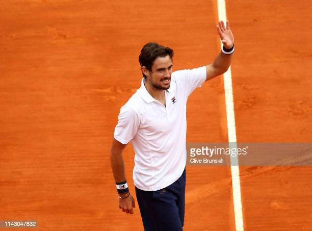 Guido Pella of Argentina celebrates to the crowd after his three set victory against Marin Cilic of Croatia in their second round match during day 3...