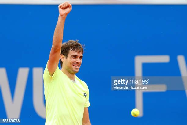 Guido Pella of Argentina celebrates victory after winning his 2nd round match against Fabio Fognini of Italy of the 102 BMW Open by FWU at Iphitos...