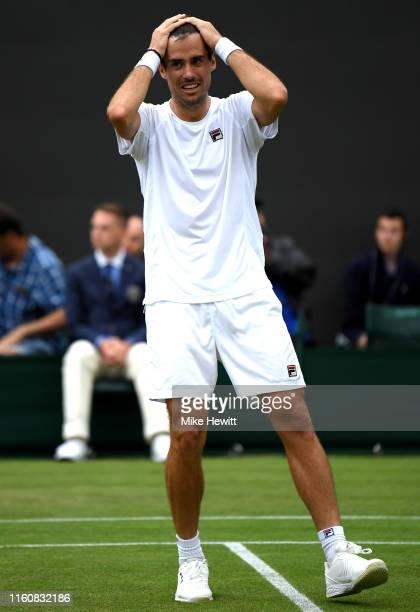 Guido Pella of Argentina celebrates victory following his Men's Singles fourth round match against Milos Raonic of Canada during Day Seven of The...