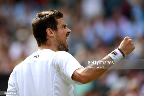 Guido Pella of Argentina celebrates victory in his Men's Singles third round match against Kevin Anderson of South Africa during Day five of The...