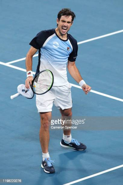Guido Pella of Argentina celebrates winning his Group E singles match against Marin Cilic of Croatiaduring day six of the 2020 ATP Cup Group Stage at...