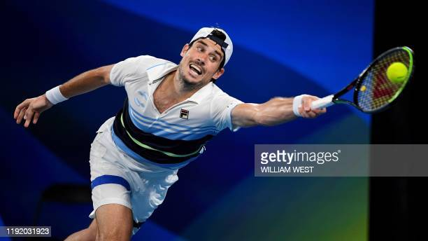 TOPSHOT Guido Pella of Argentina hits a backhand return in his men's singles match against Dennis Novak of Austria at the ATP Cup tennis tournament...