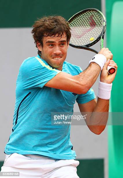 Guido Pella of Argentina hits a forehand during the Men's Singles first round match against Diego Schwartzman of Argentina on day two of the 2016...