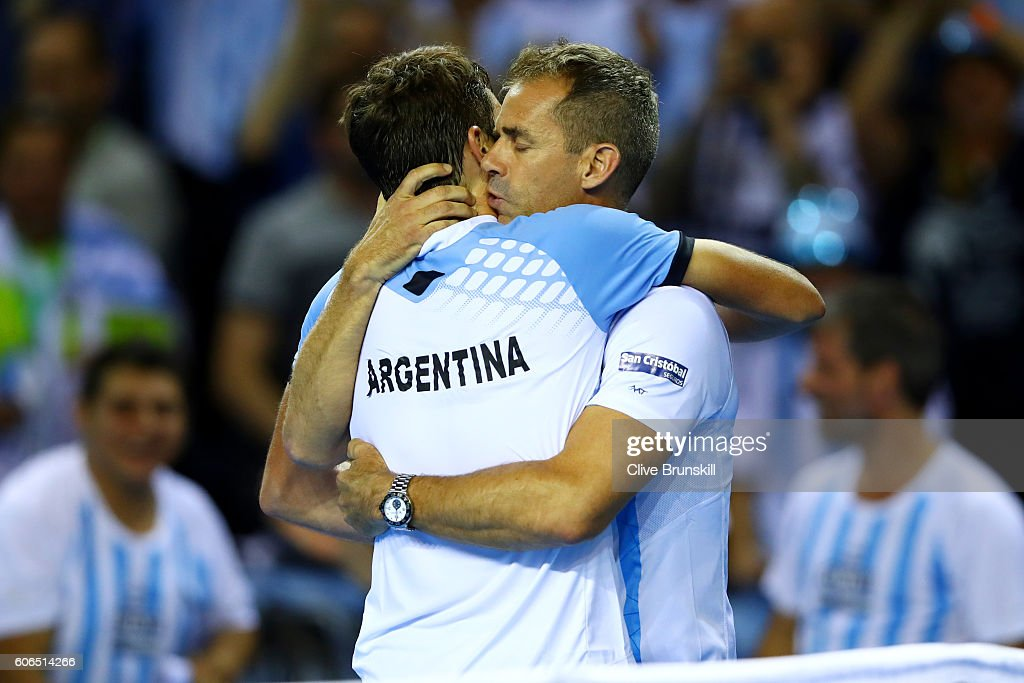 Guido Pella of Argentina is congratulated by Argentina team captain, Daniel Orsanic following his victory in his singles match against Kyle Edmund of Great Britain during day one of the Davis Cup Semi Final between Great Britain and Argentina at Emirates Arena on September 16, 2016 in Glasgow, Scotland.