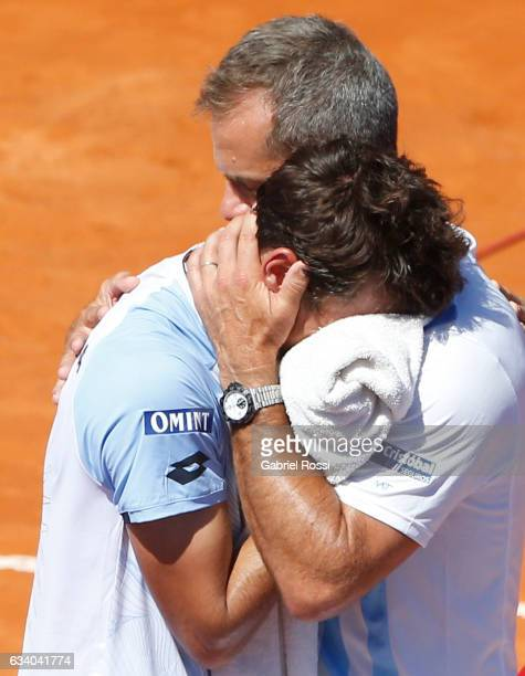 Guido Pella of Argentina looks dejected as Daniel Orsanic captain of Argentina cheers him up during a singles match between Guido Pella and Fabio...