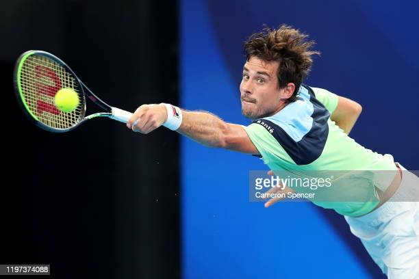 Guido Pella of Argentina plays a backhand during the Group E singles match against Kamil Majchrzak of Poland during day two of the 2020 ATP Cup Group...