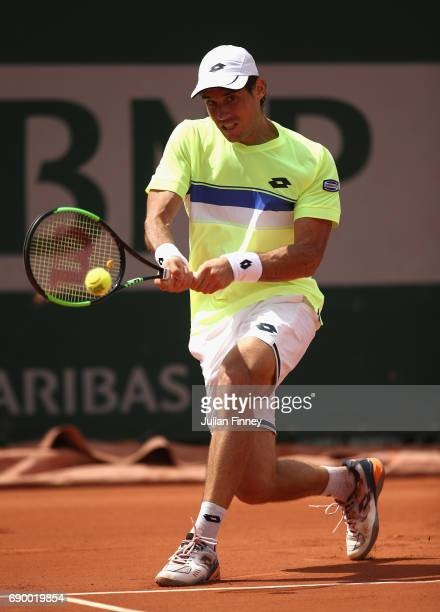 Guido Pella of Argentina plays a backhand during the mens singles first round match against Juan Martin Del Potro of Argentina on day three of the...