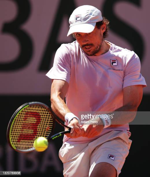 Guido Pella of Argentina plays a backhand in his First Round match against Daniel Elahi Galan of Colombia during Day One of the 2021 French Open at...