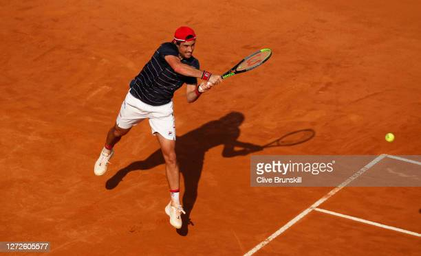 Guido Pella of Argentina plays a backhand in his round one match against Denis Shapovalov of Canada during day two of the Internazionali BNL d'Italia...