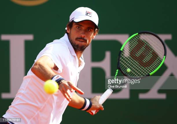 Guido Pella of Argentina plays a forehand against Marco Cecchinato of Italy in their third round match during day five of the Rolex MonteCarlo...