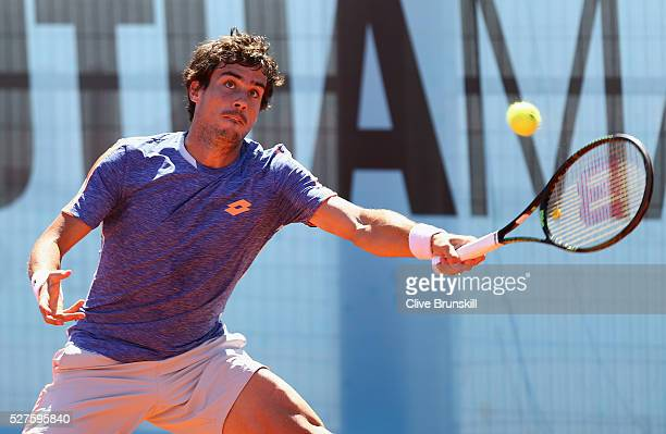 Guido Pella of Argentina plays a forehand against Nick Kyrgios of Australia in their first round match during day four of the Mutua Madrid Open...