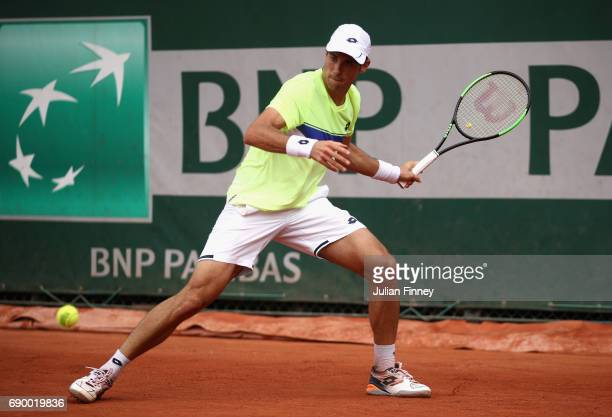 Guido Pella of Argentina plays a forehand during the mens singles first round match against Juan Martin Del Potro of Argentina on day three of the...