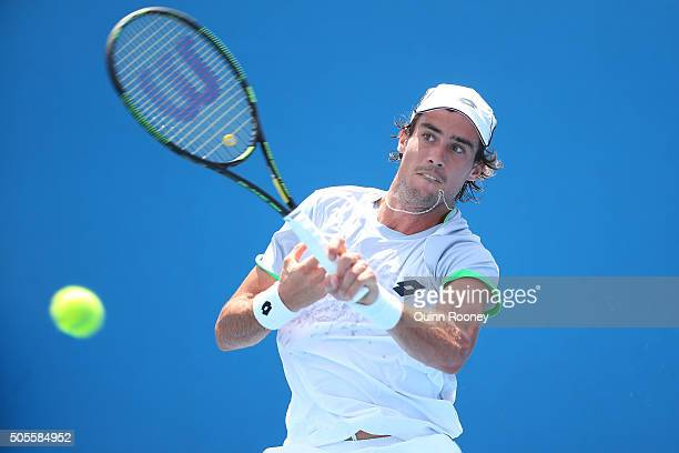 Guido Pella of Argentina plays a forehand in his first round match against Steve Darcis of Belgium during day two of the 2016 Australian Open at...