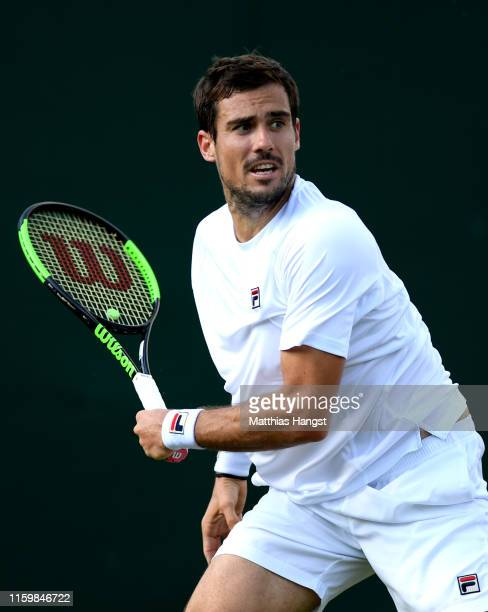 Guido Pella of Argentina plays a shot in his Men's Singles second round match against Andreas Seppi of Italy during Day three of The Championships...
