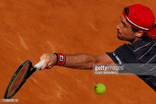 Guido Pella of Argentina reaches out for a backhand to Denis Shapovalov of Canada on day two of the Italian Open at Foro Italico on September 15,...