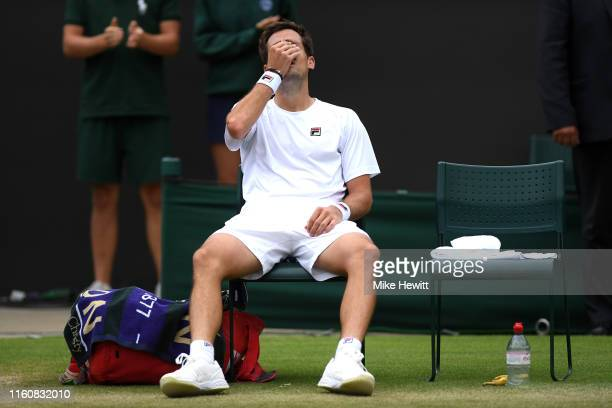 Guido Pella of Argentina reacts following victory in his Men's Singles fourth round match against Milos Raonic of Canada during Day Seven of The...