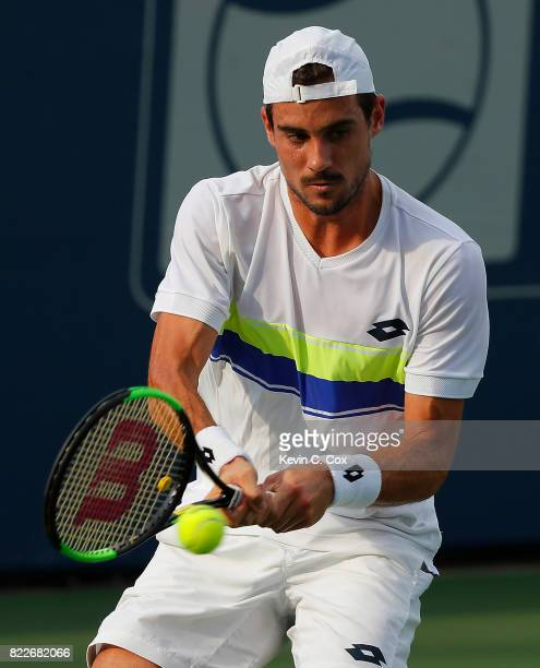 Guido Pella of Argentina returns a backhand to Peter Gojowczyk of Germany during the BBT Atlanta Open at Atlantic Station on July 25 2017 in Atlanta...