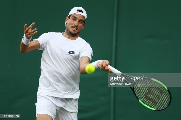 Guido Pella of Argentina returns a shot against Mackenzie McDonald of the United States during their Men's Singles third round match on day five of...