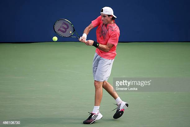 Guido Pella of Argentina returns a shot against Marin Cilic of Croatia during their Men's Singles First Round match on Day One of the 2015 US Open at...