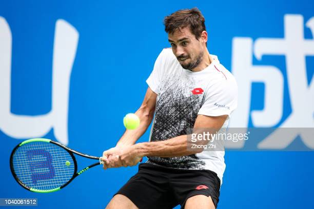 Guido Pella of Argentina returns a shot against Sam Querrey of the United States during 2018 ATP World Tour Chengdu Open at Sichuan International...