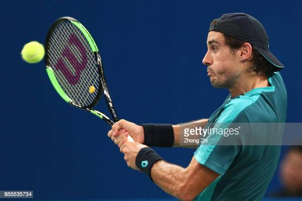 Guido Pella of Argentina returns a shot during the match against Taylor Fritz of the United States during Day 5 of 2017 ATP Chengdu Open at Sichuan...