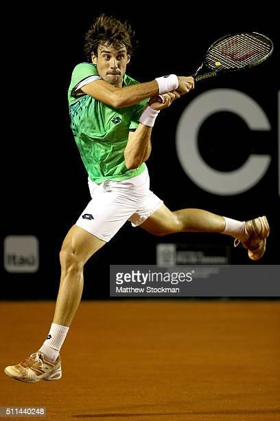 Guido Pella of Argentina returns a shot to Dominic Thiem of Austria during the Rio Open at Jockey Club Brasileiro on February 20 2016 in Rio de...