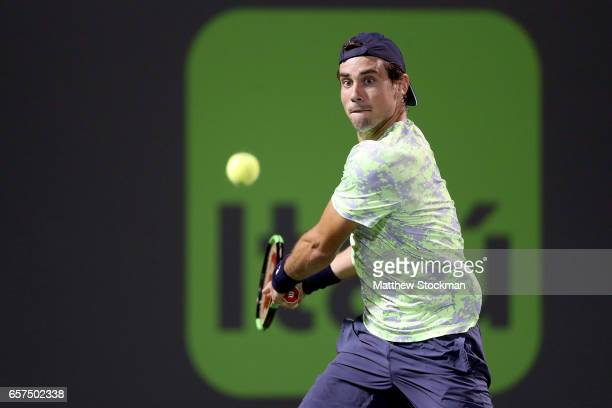 Guido Pella of Argentina returns a shot to Grigor Dimitrov of Bulgaria during the Miami Open at the Crandon Park Tennis Center on March 24 2017 in...