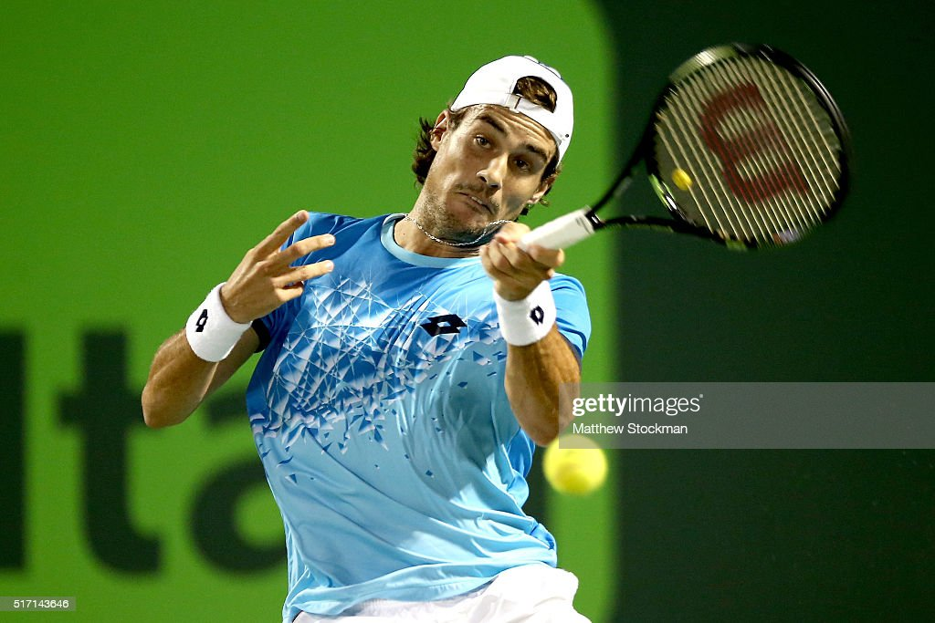 Guido Pella of Argentina returns a shot to Juan Martin Del Potro of Argentina during the Miami Open presented by Itau at Crandon Park Tennis Center on March 23, 2016 in Key Biscayne, Florida.