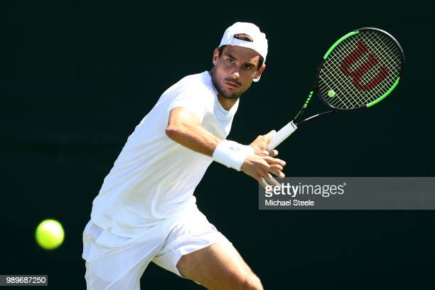 Guido Pella of Argentina returns to Jason Kubler of Australia during their Men's Singles first round match on day one of the Wimbledon Lawn Tennis...